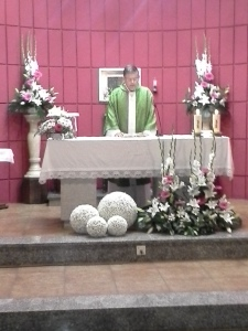 Michael celebrating the Eucharist for the group at a local church