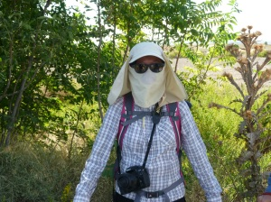 Tracy protecting herself from the dusty conditions she is about to encounter in the desert