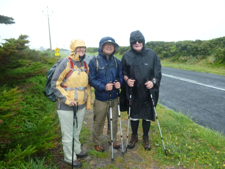 Geraldine, Yasu and Michael in the rain early in the walk