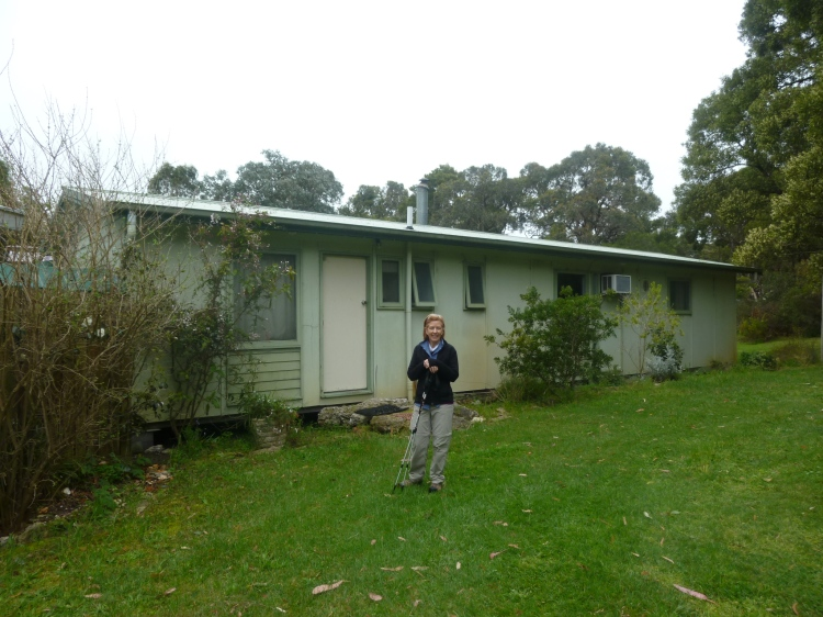 Helen outside the group's accommodation at Bush Haven